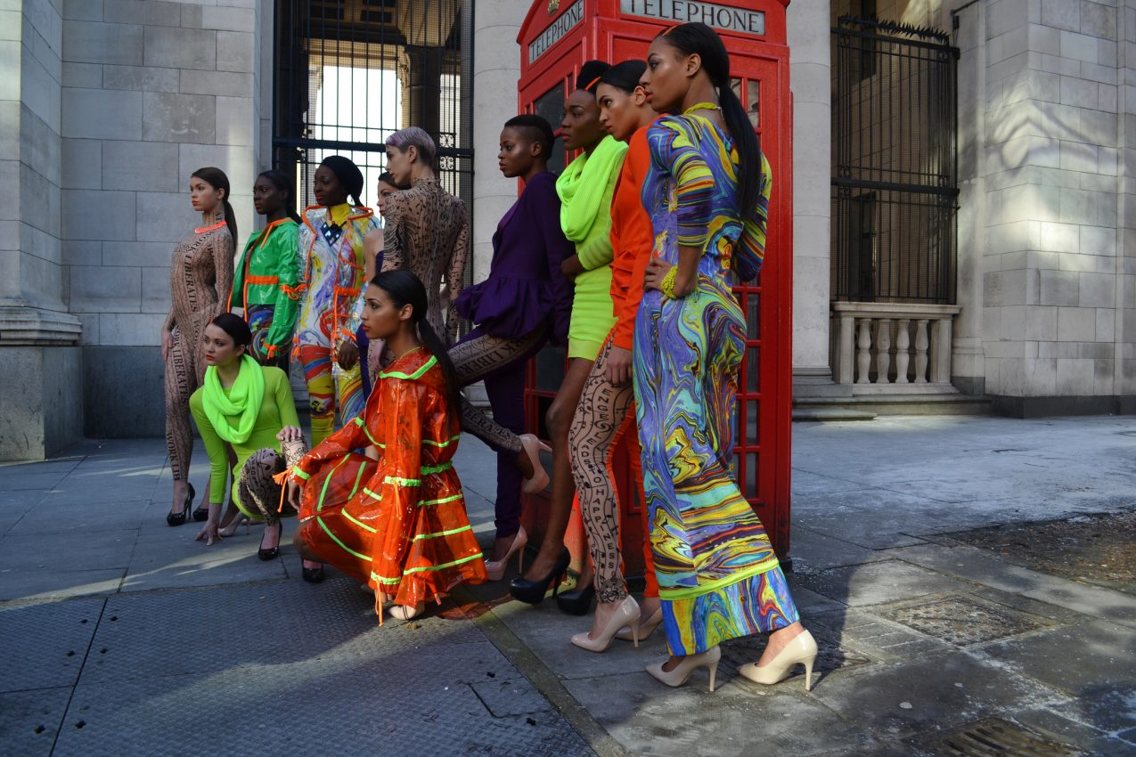 10 london fashion week models posing by telephone booth