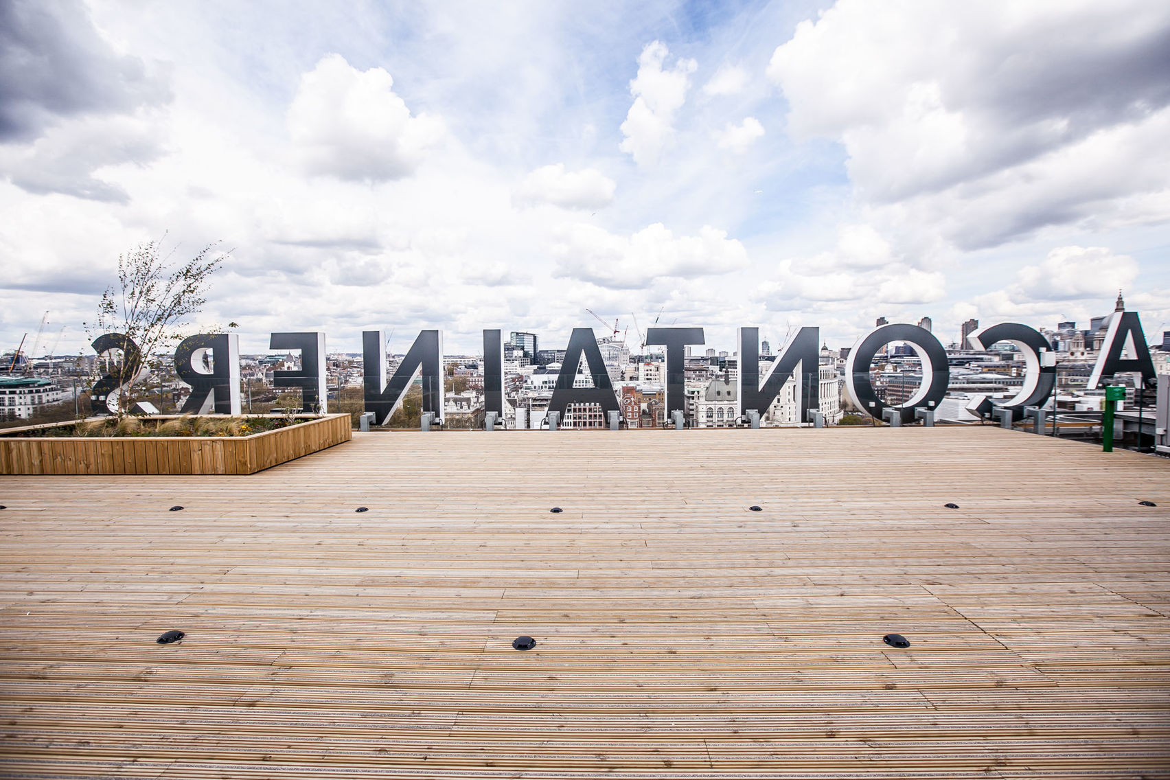 sea containers wooden roof terrace