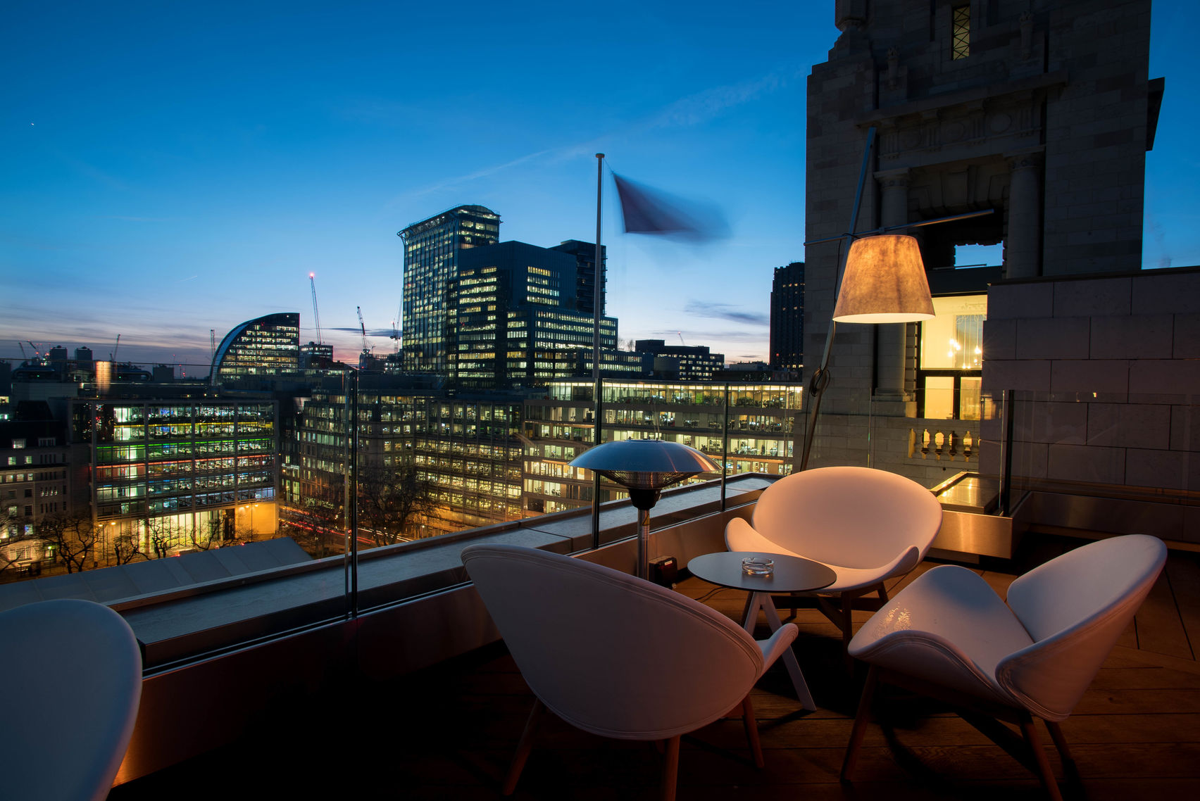beautiful rooftop bar overlooking London skyline
