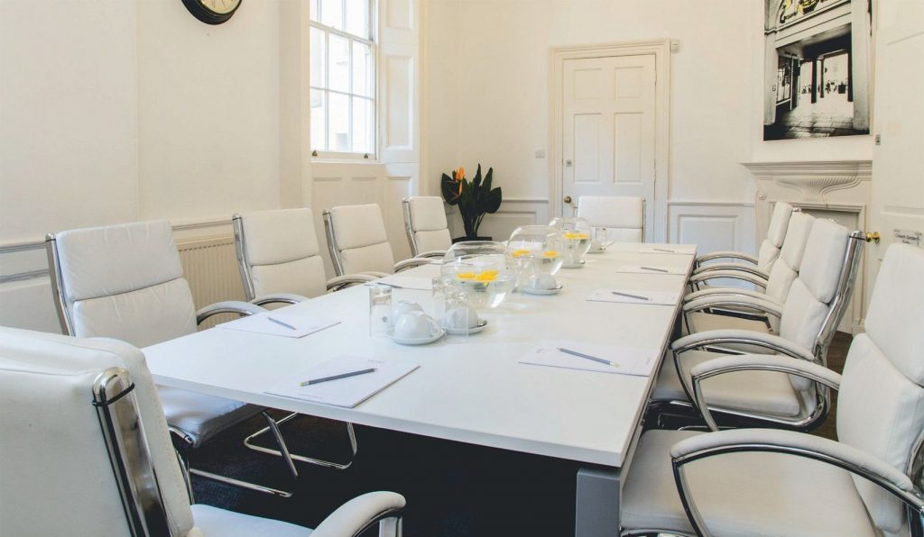 meeting room with long white table