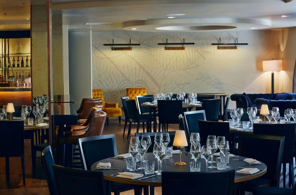 elegant restaurant with several circular tables