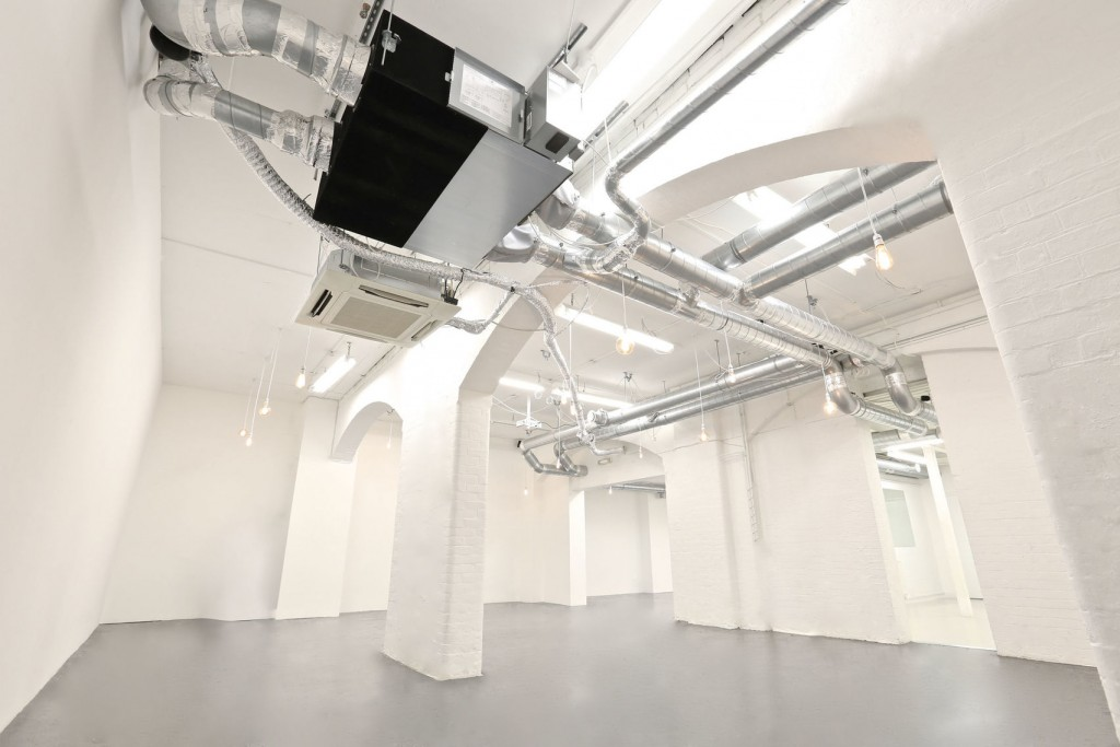 white venue with industrial ceiling pipes