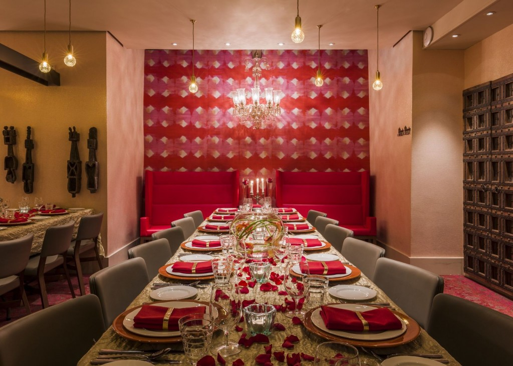 dining room with bright red wall