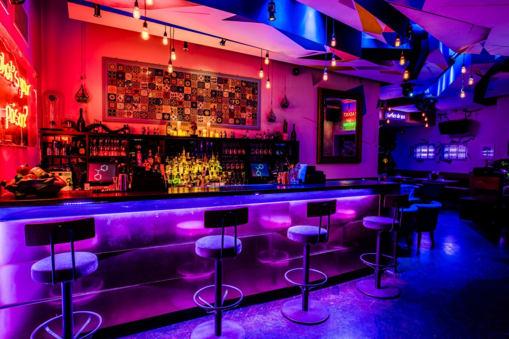 atmospheric club with brightly coloured bar