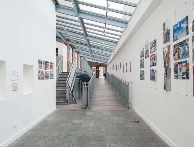 White-walled art gallery with framed art on the wall