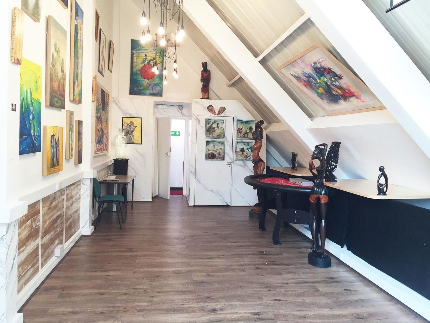 A small art gallery with a slanted roof.
