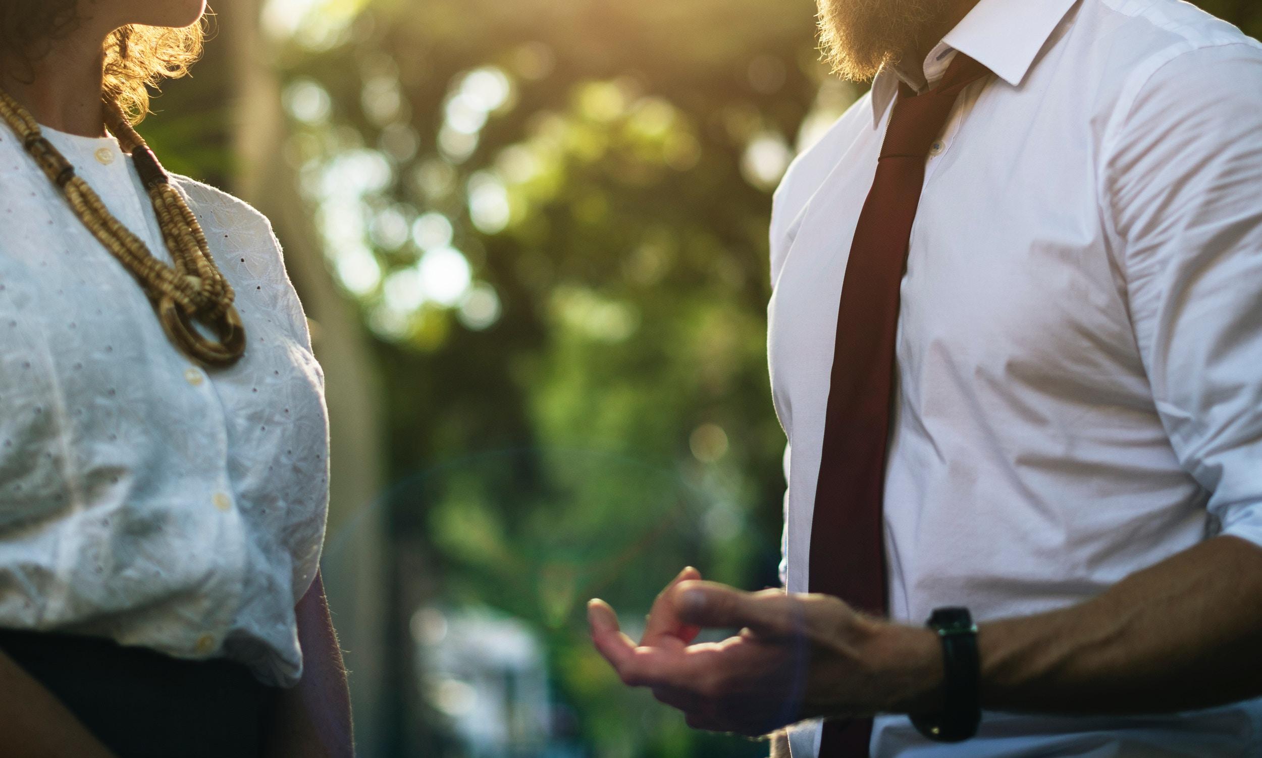 man and women stood in work wear