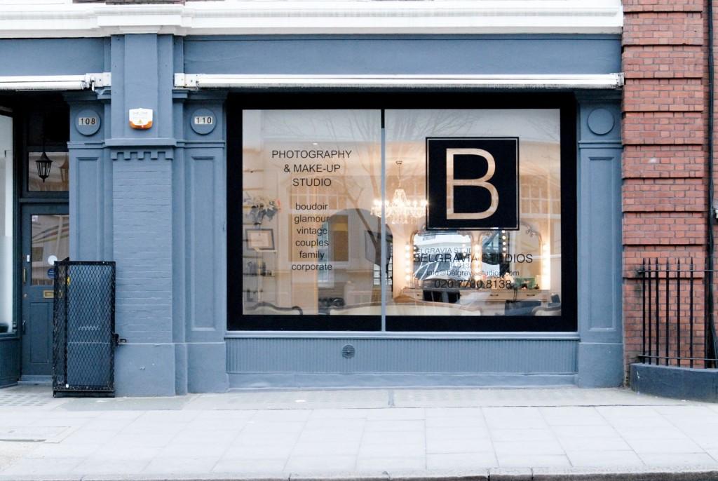 outside a large windowed blue shop