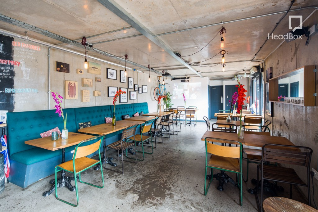 chic cafe with blue cushioned seating