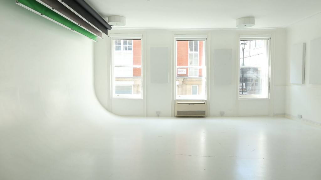 A large white studio with windows on the back wall.