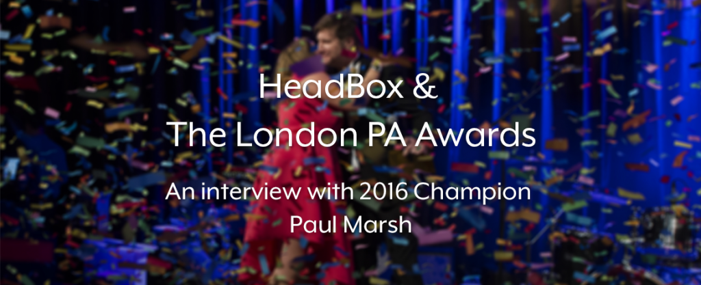 an image of a young couple embracing, the woman is wearing a hot pink dress and the man a suit. There is confetti falling all around them and a white text overlays the image that reads 'HeadBox & The London PA Awards. An Interview with 2016 Champion Paul Marsh'