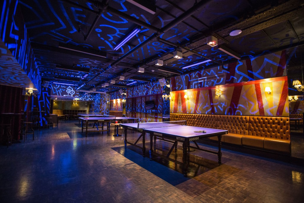 ping pong tables in blue room