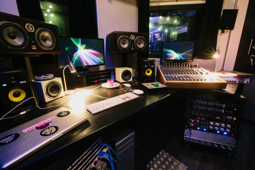 Studio 2, Play Deep Studios a large black desk with big recording equipment on top of it. There are several speakers, screens and mixing desks.