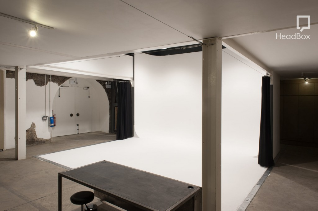 A studio with a large white backdrop.