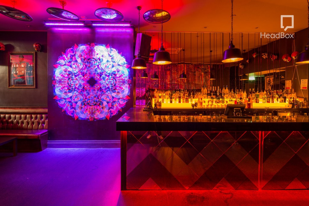 red, orange and purple lit bar