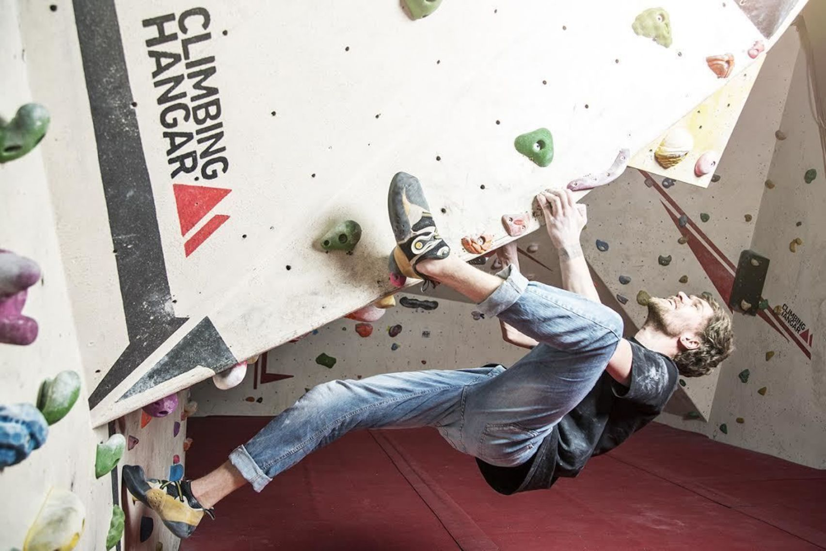 A man on a climbing wall.