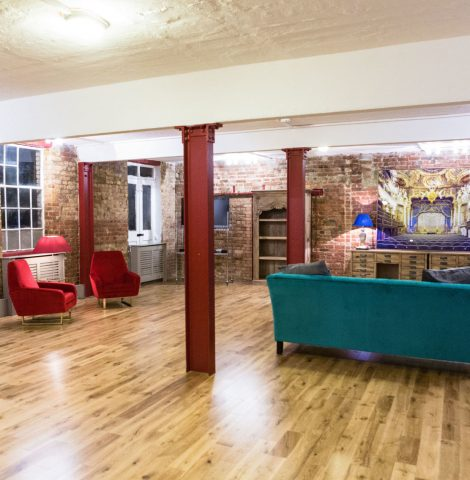 large workshop venue with colourful sofas