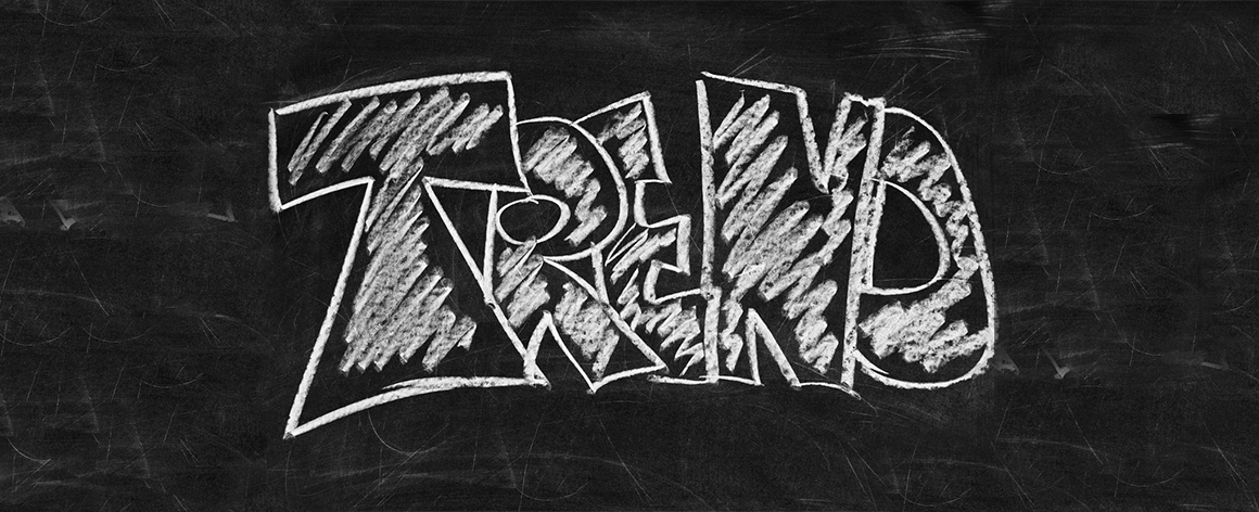 The word 'trend' written in block capitals with white chalk on a blackboard