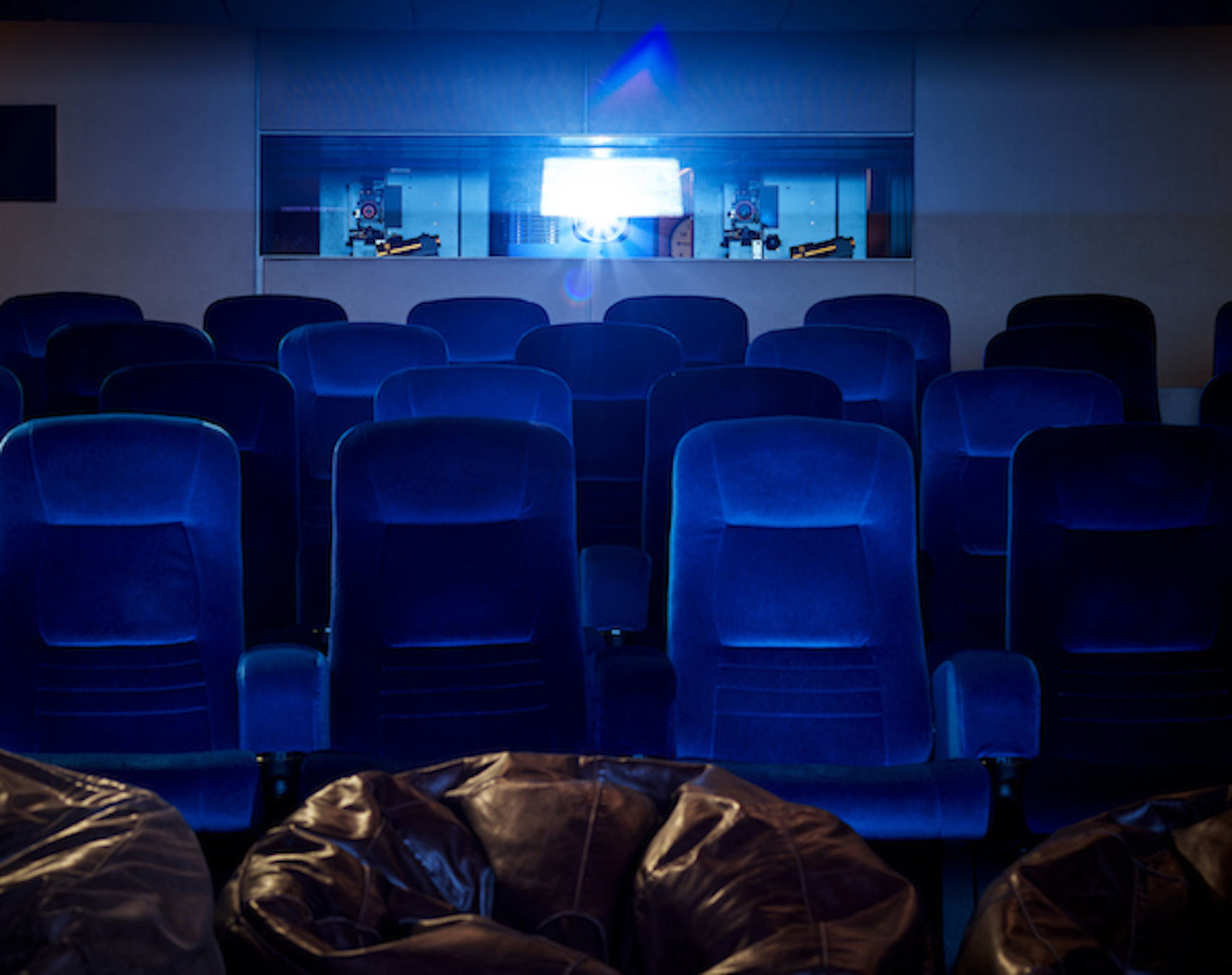 Rows of electric blue cinema seats