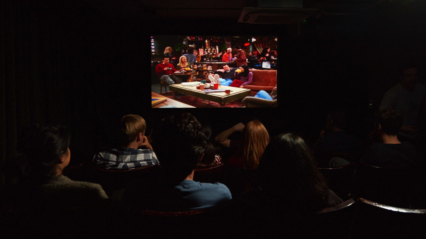 Rows of people watching Friends in a cinema