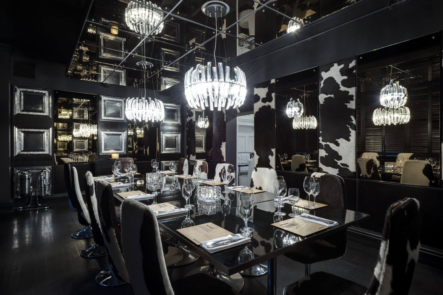 A private dining room in Manchester with cow print decor