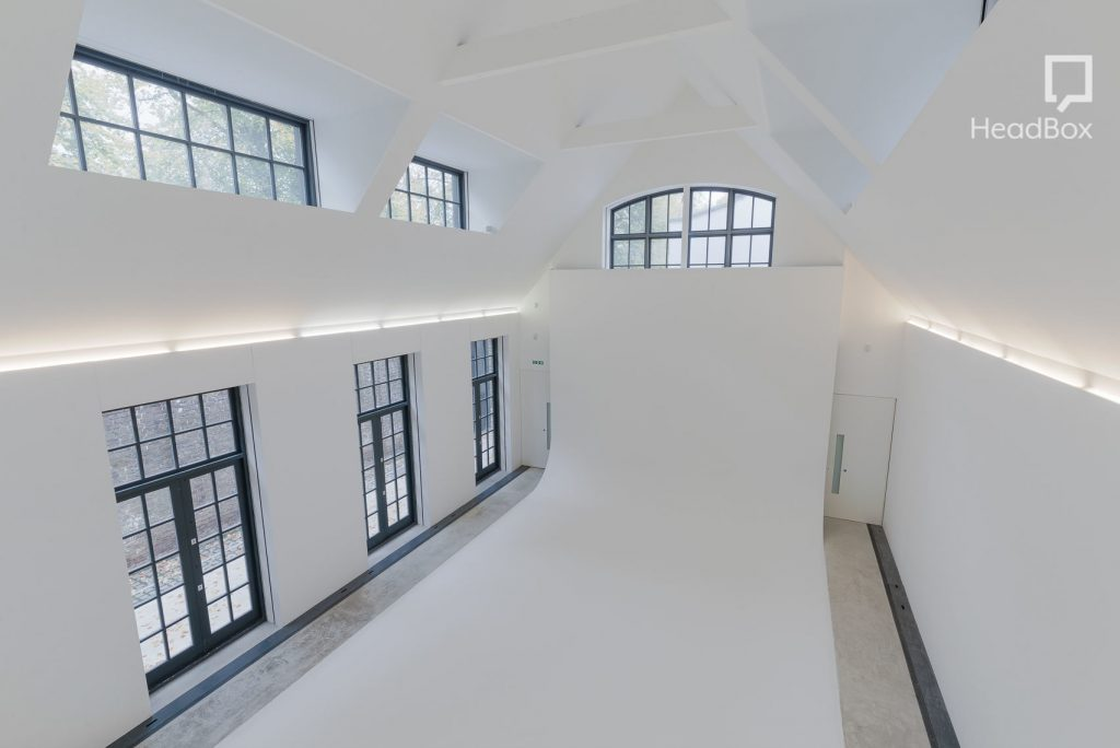 white studio with cross-hatched windows