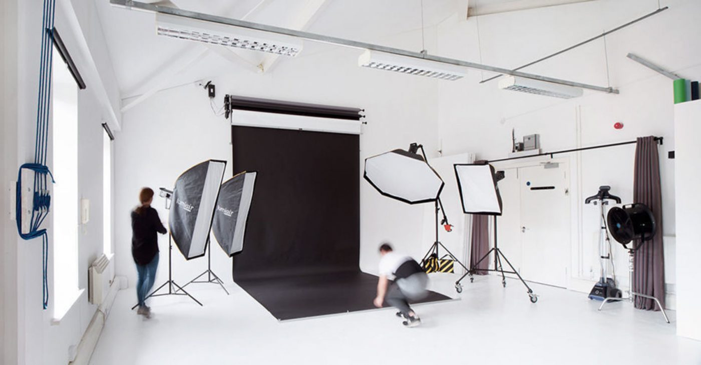 Photography studio with black backdrop