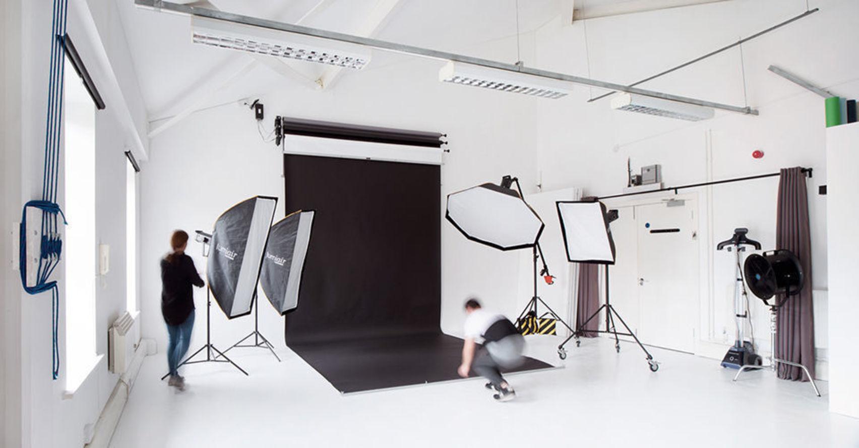 Photography studio with black backdrop