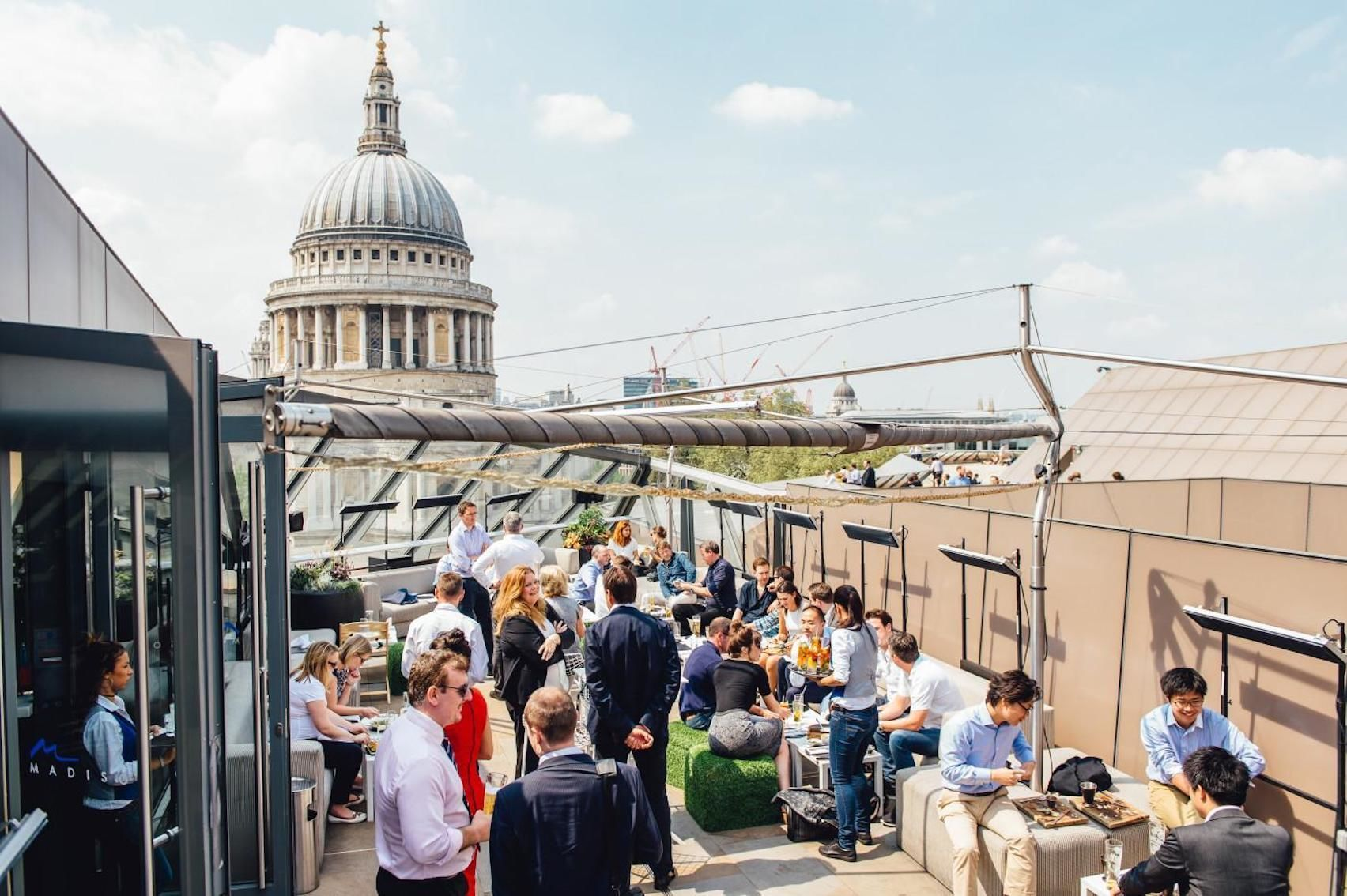 A rooftop terrace with St.Pauls in the background
