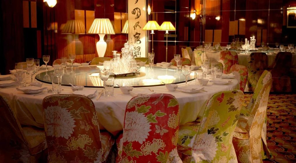 an oriental private dining room with a large white circular table in the centre