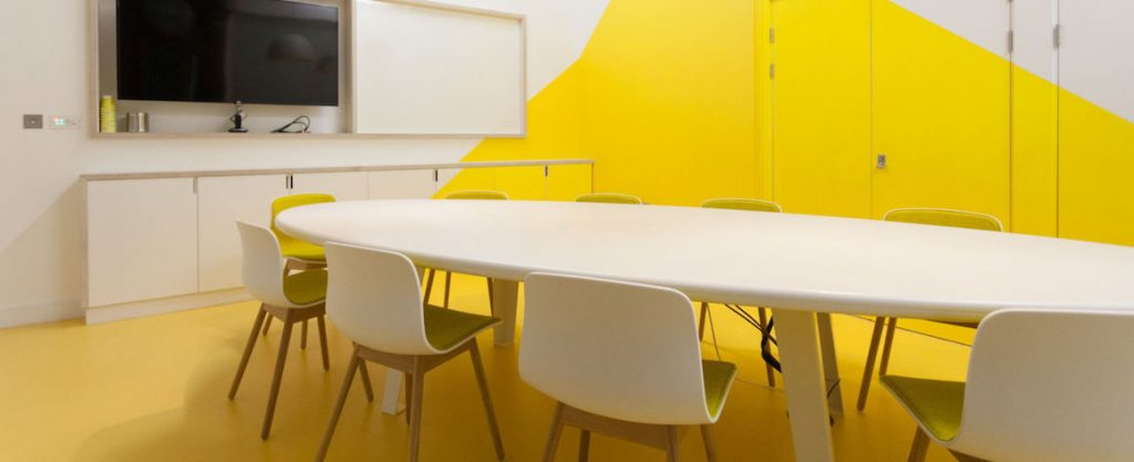 meeting room with bright yellow flooring