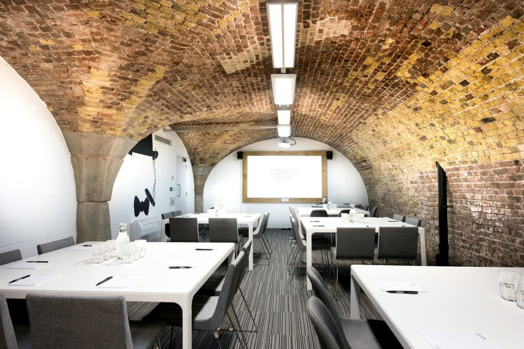 white walled space with brick ceiling