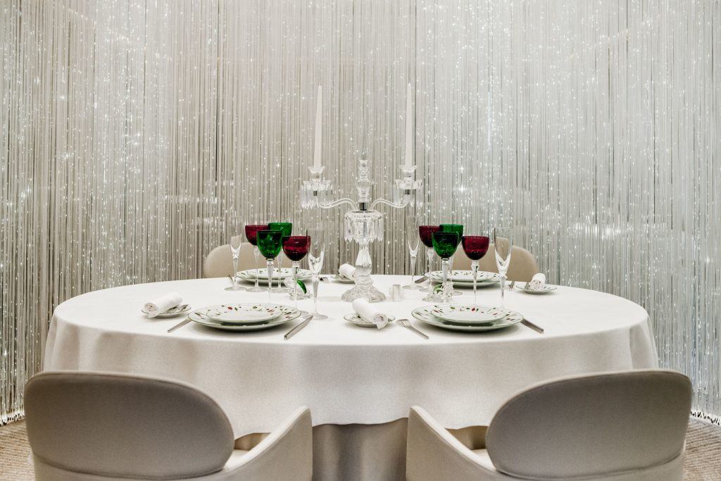 white circular table with optic curtain surroundings