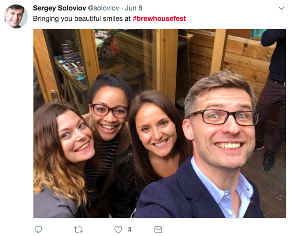 a screenshot taken from a tweet that reads 'bringing you beautiful smiles at #brewhousefest' with a photo attached of 4 people smiling at the camera