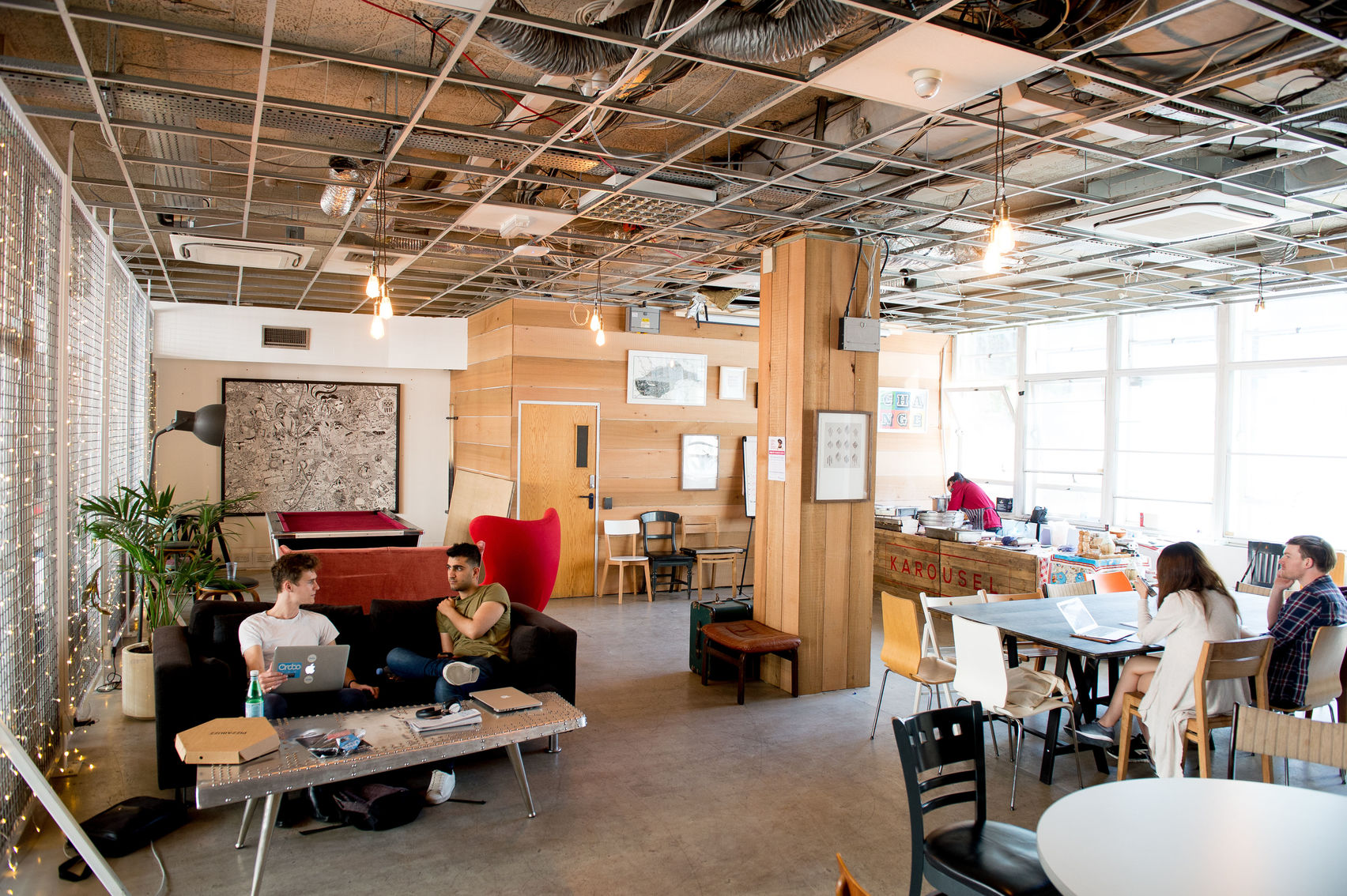 A co-working space with sofas and desks.