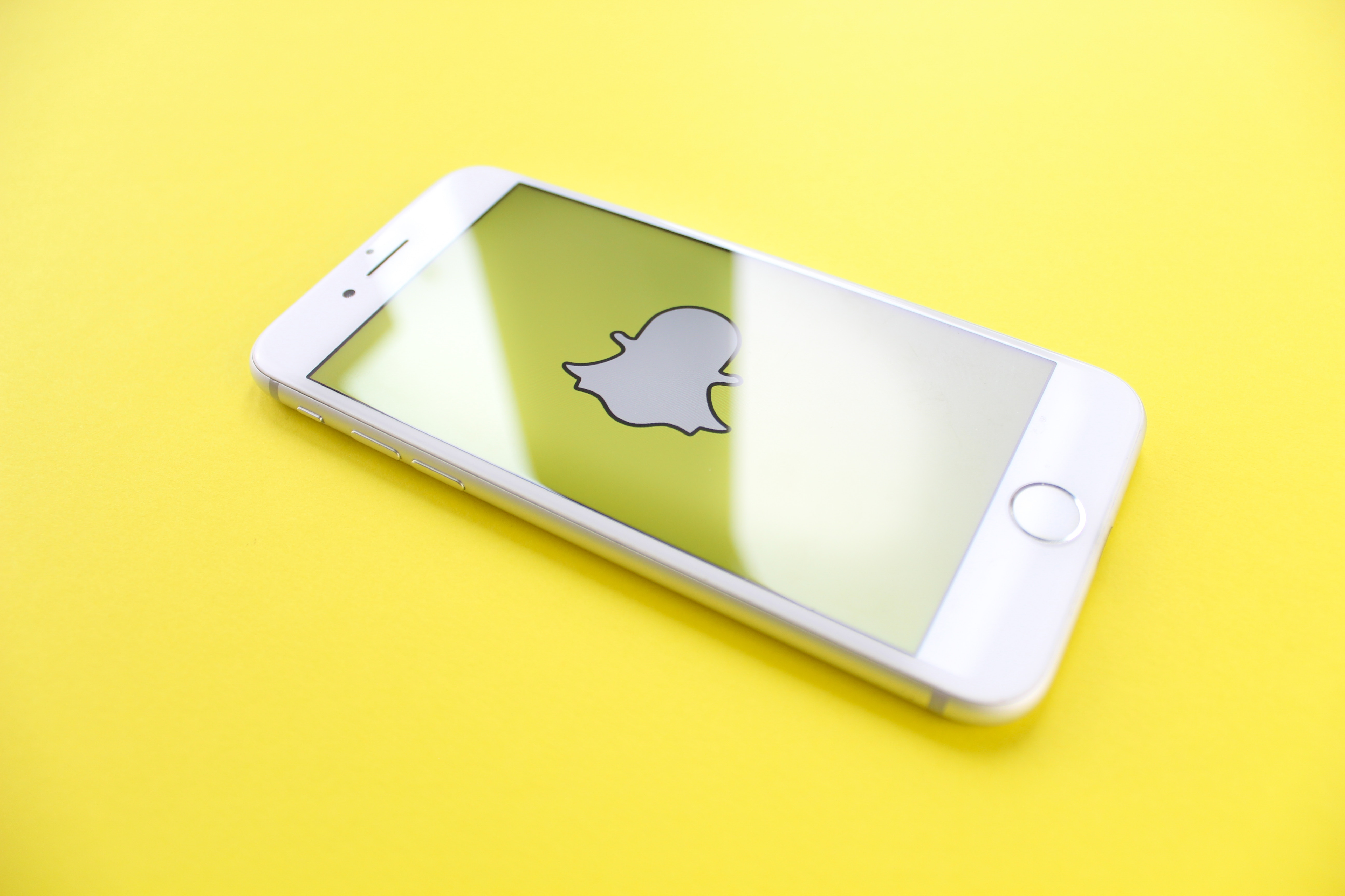 Phone on yellow background