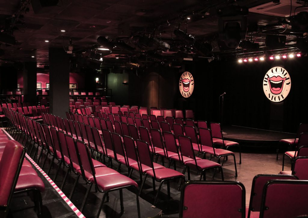 red theatre style seats facing stage