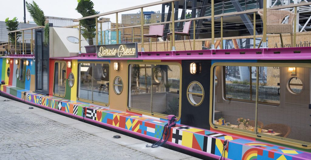 colourful barge boar with windows