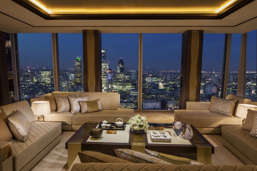 A rooftop bar in the shard with cream sofas and chairs overlooking the city skyline