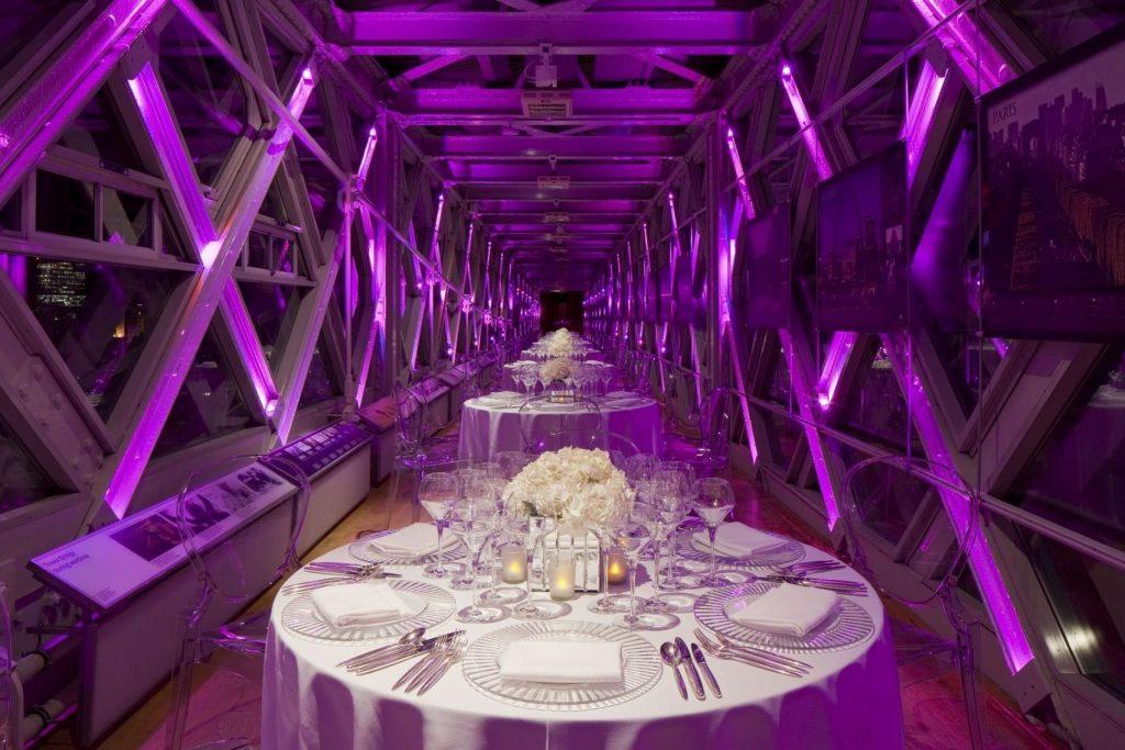 purple lit walkaway above tower bridge