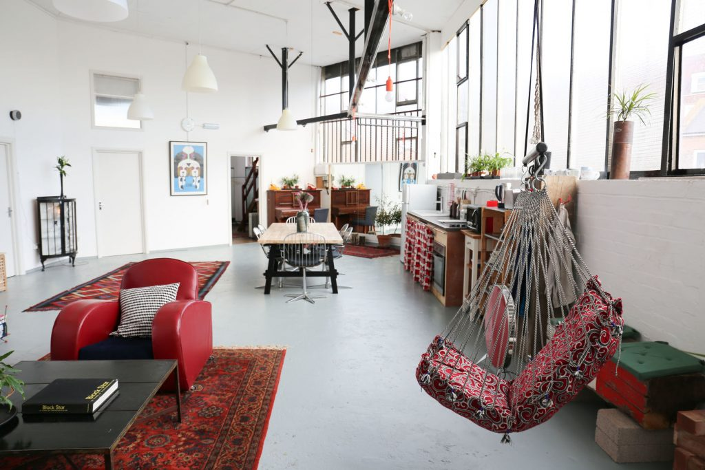 white loft with red furnishings