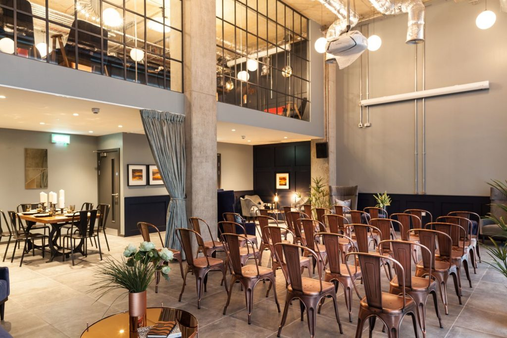 A beautiful modern event Space. With high ceilings and copper coloured chairs this is great for a conference or networking event.
