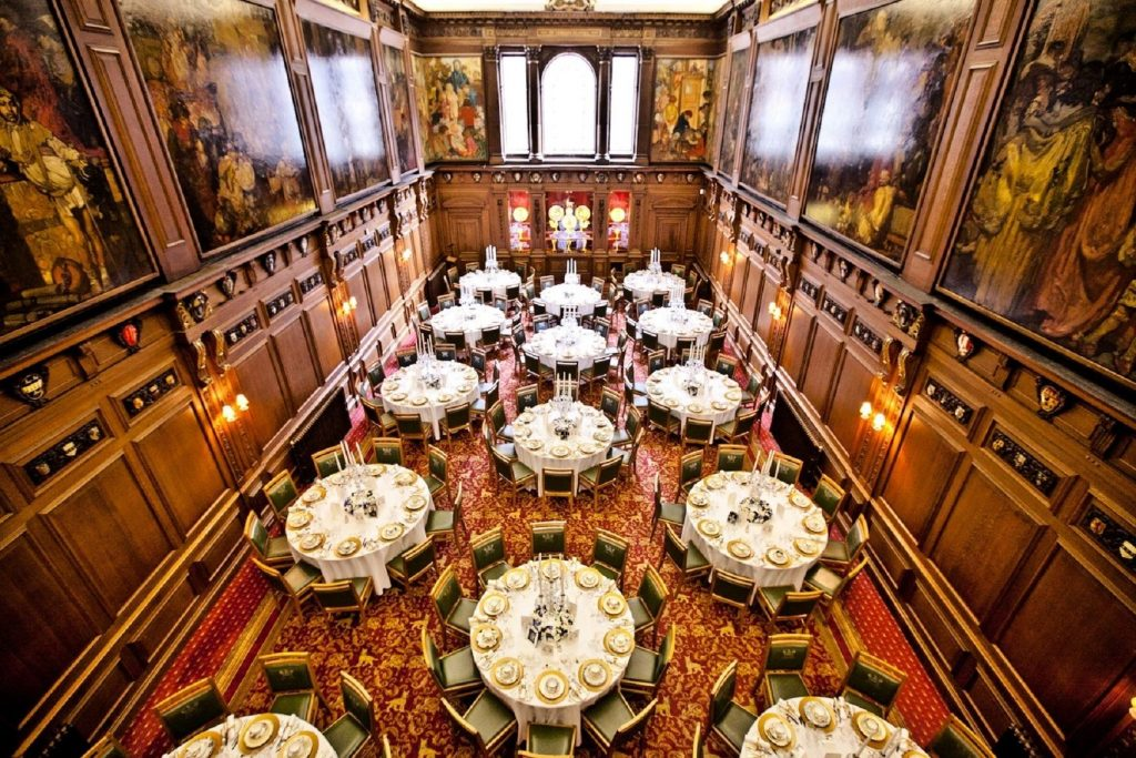 Skinners Hall is a grand, historic Space to hire in London. The hall has wood panelling and large oil paintings hanging from the walls. The photo is taken above and you can see the cabaret style tables below.