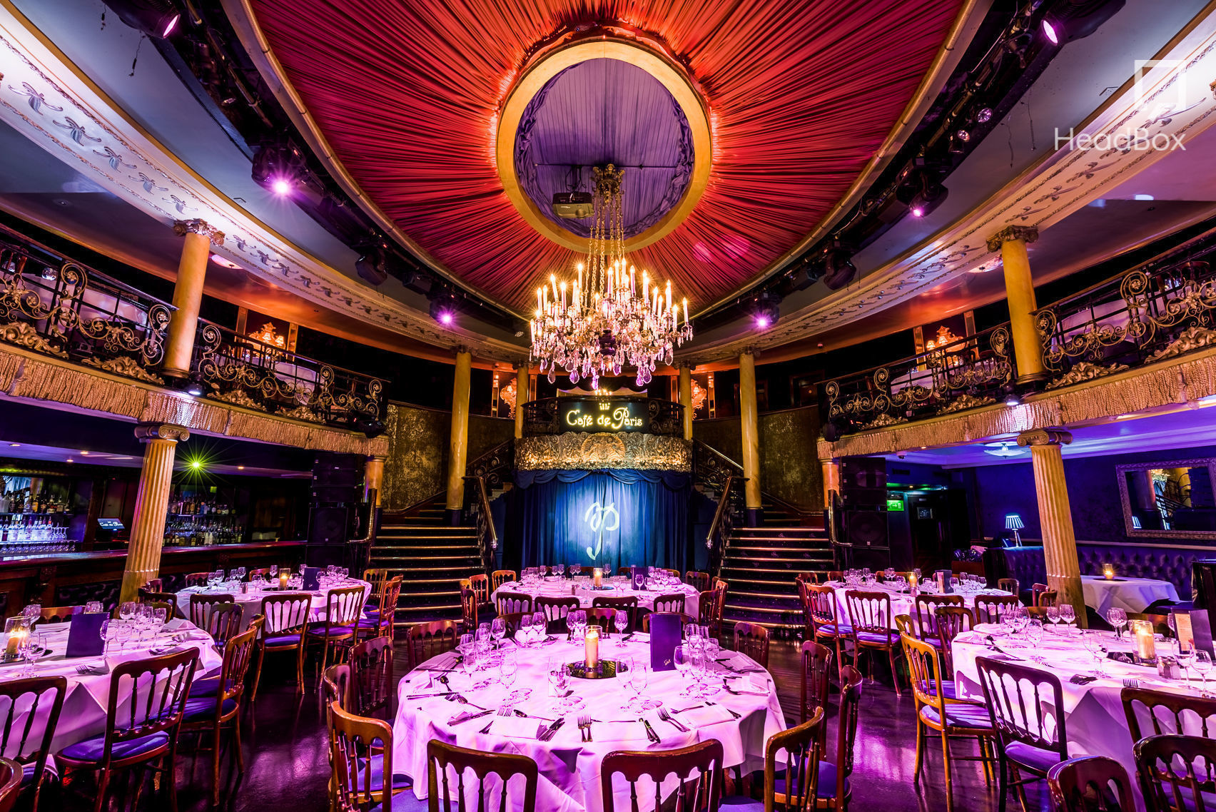 cafe de paris is a large theatrical building the image is of the stage area