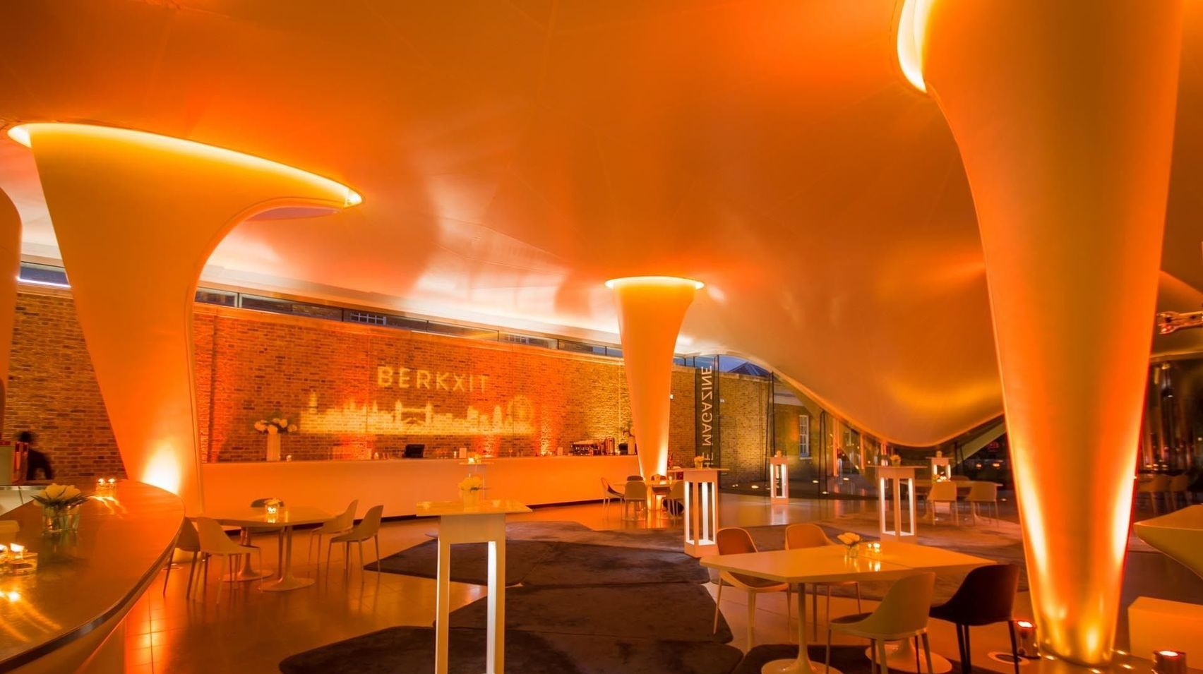 Serpentine Gallereis is an unusual Christmas party venue in London. With curved yellow and orange ceiling