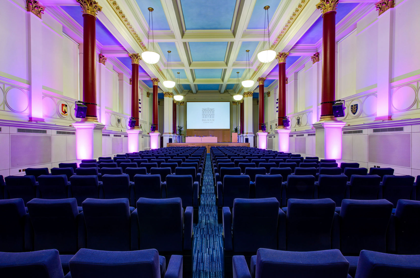 A large conference venue with high ceilings
