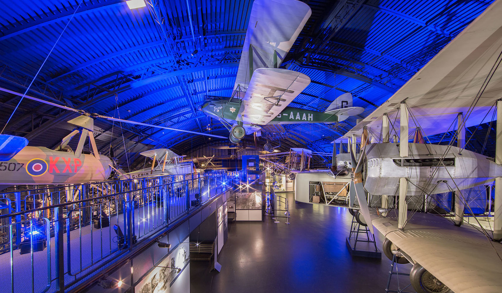 a mezzanine level event space at the science museum with large aviation places hanging from the ceilings