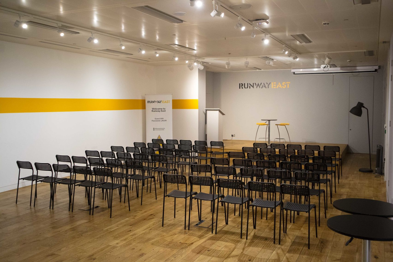 a large workshop space set up for a conference at runway east