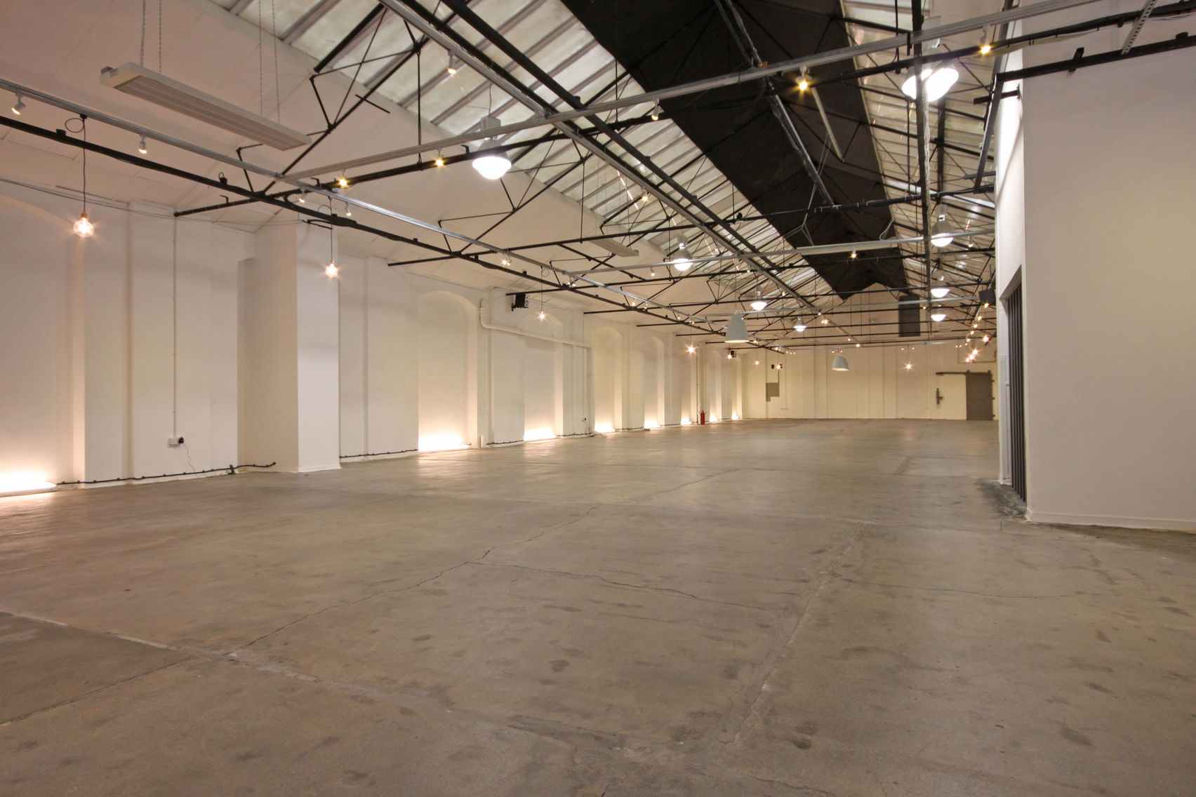 A large empty warehouse Space with vaulted ceilings