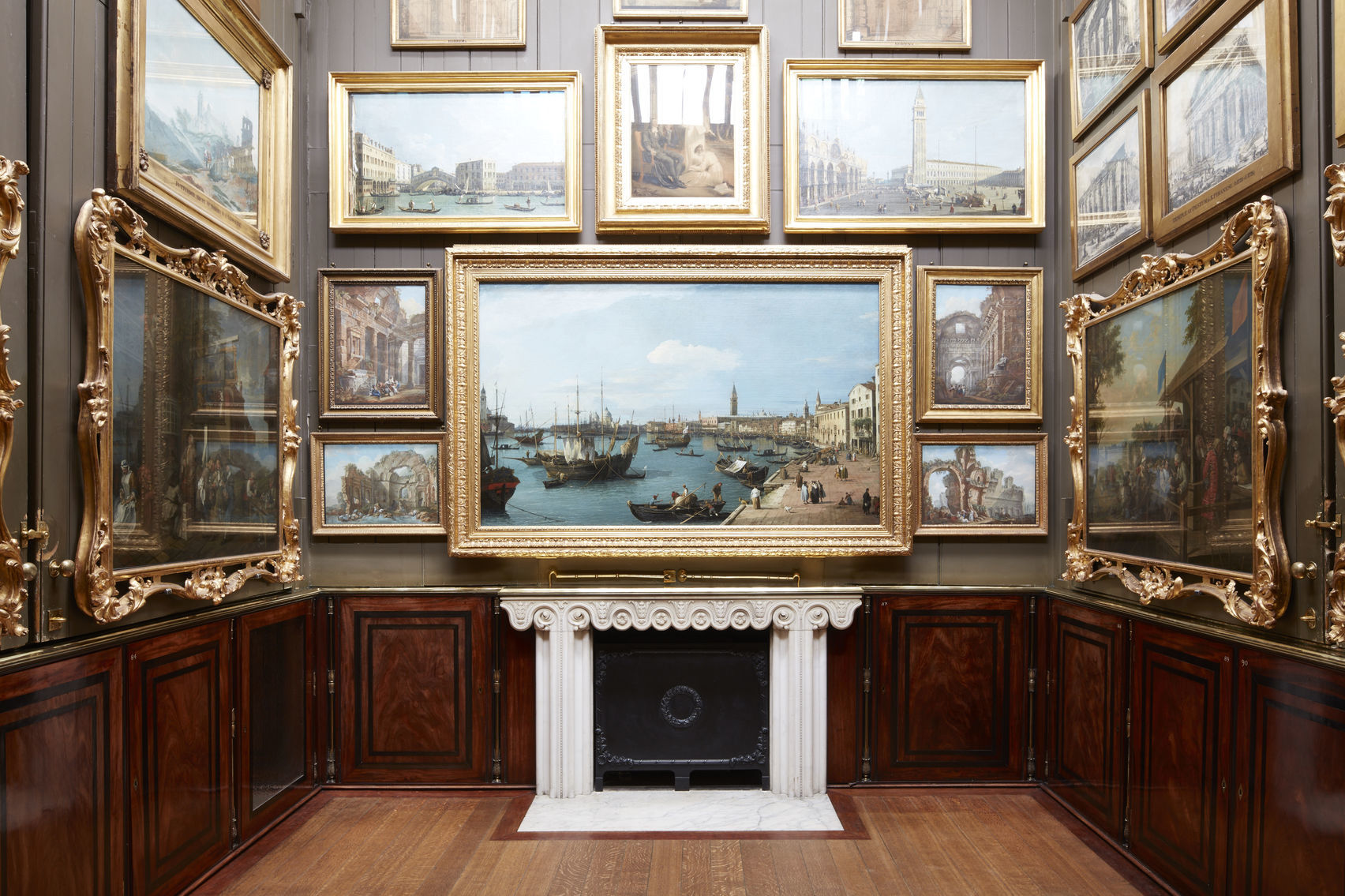 A room in Sir John Soane's Museum covered in paintings in gold frames
